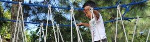 Child on rope bridge